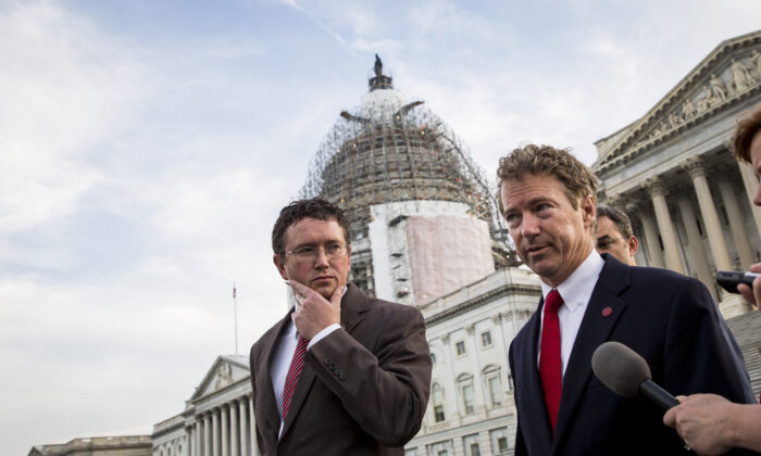 Rep. Thomas Massie (R-Ky.), left, listens as Sen. Rand Paul (R-Ky.) speaks to reporters on Capitol Hill, in Washington on May 31, 2015. (Drew Angerer/Getty Images)