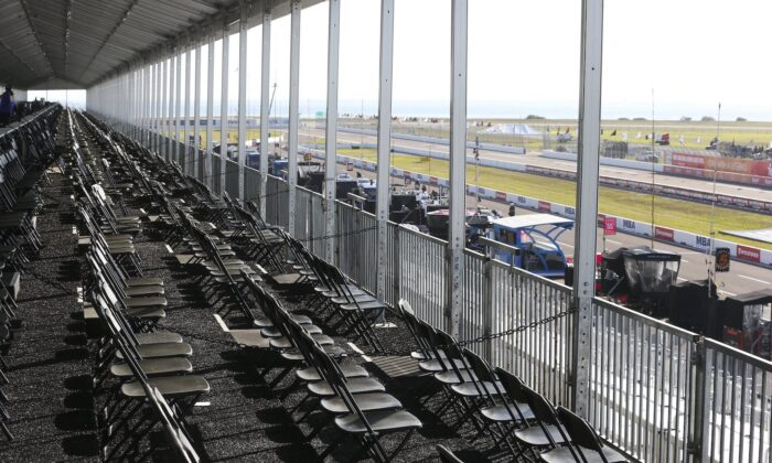 The spectator VIP area overlooking pit lane is virtually empty during the opening day of the Firestone Grand Prix of St. Petersburg in St. Petersburg, on March 13, 2020. (Dirk Shadd/Tampa Bay Times via AP)