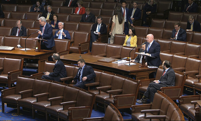 In this image from video, Rep. Kevin McCarthy (R-Texas), left, and Rep. Kevin Brady (R-Texas) stand as they speak on the floor of the House of Representatives at the U.S. Capitol in Washington on March 27, 2020. (House Television via AP)