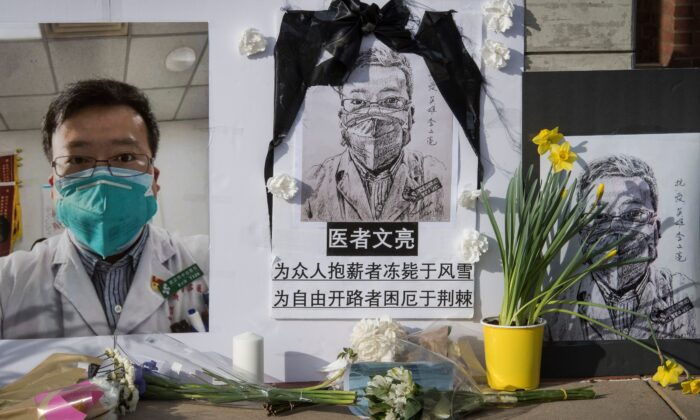 Chinese students and their supporters hold a memorial for Dr Li Wenliang, who was the whistleblower of the CCP Virus that originated in Wuhan, China and caused the doctors death in that city, outside the UCLA campus in Westwood, California, on Feb. 15, 2020. (Mark Ralston/AFP via Getty Images)