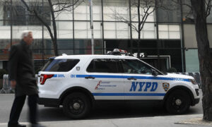 2 New York Residents Charged With Torching NYPD Van