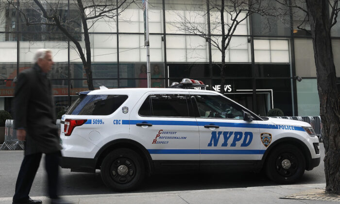 New York City police lost its first detective to Covid-19, marking the third NYPD death to the disease that has afflicted the department.(Spencer Platt/Getty Images)