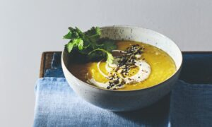 Red Lentil Soup With Turmeric, Masala Yogurt, Toasted Seeds, and Cilantro