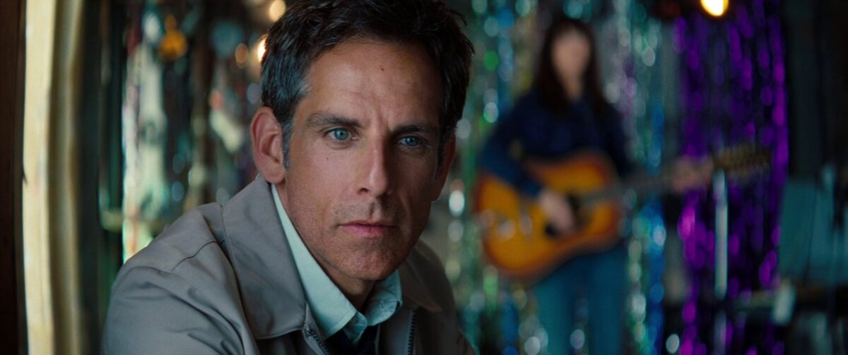 """Man with tan jacket, women with guitar in """"The Secret Life of Walter Mitty"""""""