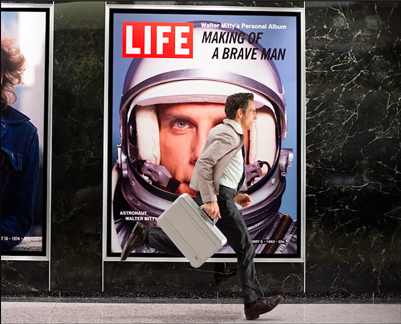 """man running with briefcase in """"The Secret Life of Walter Mitty"""""""