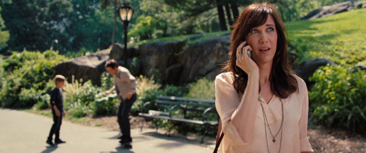"""boy, man on skateboard, woman on phone in """"The Secret Life of Walter Mitty"""""""