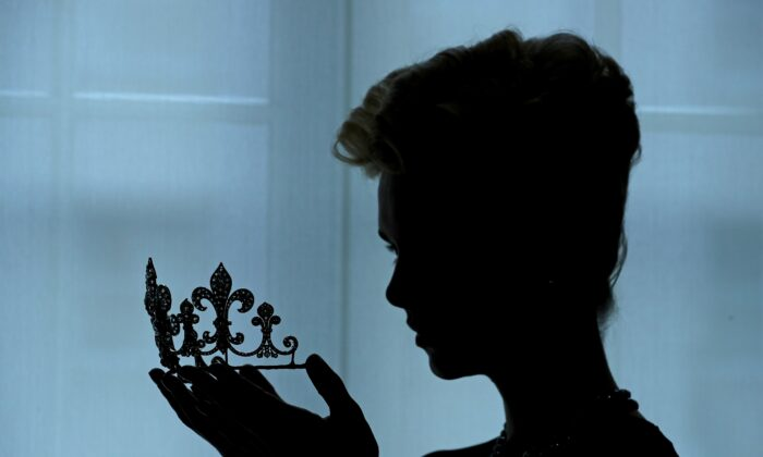 A model poses with a diamond tiara from the Boubon-Parma royal family in a file photograph. (Daniel Leal-Olivia/AFP via Getty Images)