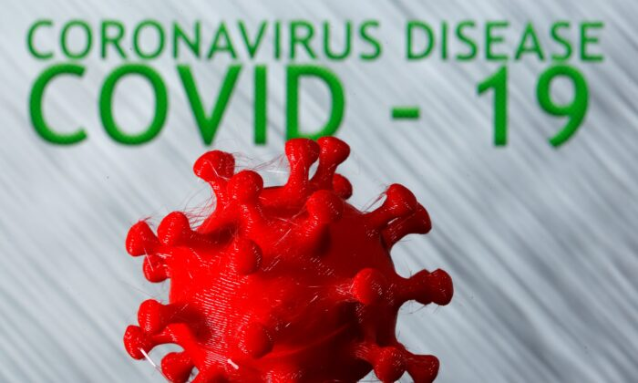 A 3D-printed coronavirus model is seen in front of the words coronavirus disease (Covid-19) on display in this illustration taken March 25, 2020. (Dado Ruvic/Reuters)