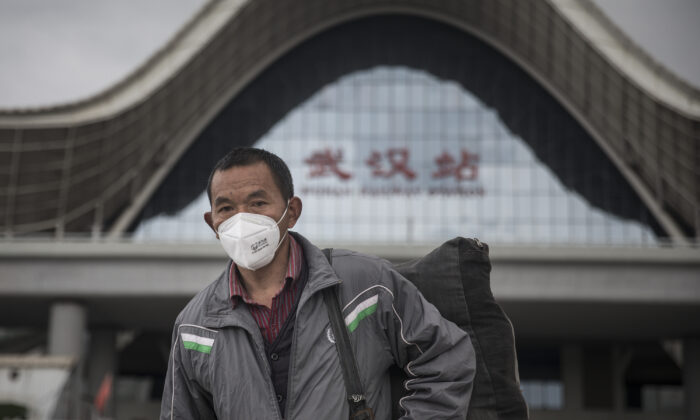 A passenger wears a mask after arriving in Wuhan Railway Station in Wuhan, Hubei Province, China, on March 28, 2020. (Getty Images)