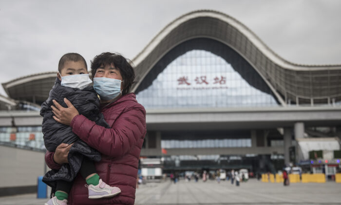 A woman and child arrive at Wuhan Railway Station in Wuhan, Hubei Province, China, on March 28, 2020. (Getty Images)