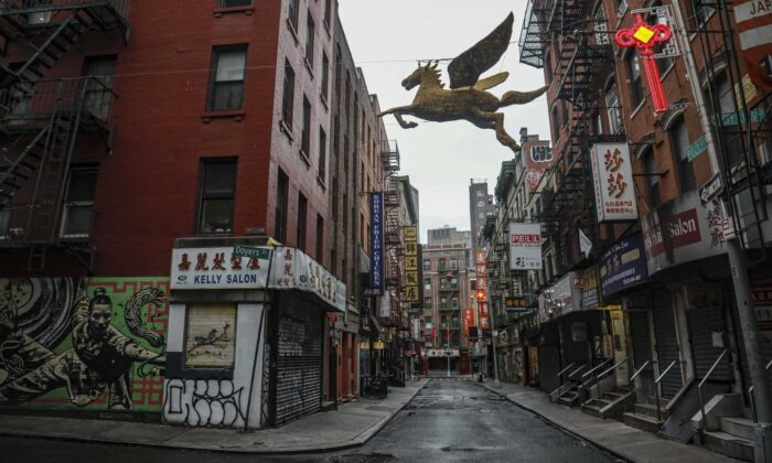 A street in New York's Chinatown is empty, the result of citywide restrictions calling for people to stay indoors and maintain social distancing in an effort to curb the spread of COVID-19, in New York on March 28, 2020. (Bebeto Matthews/AP Photo)
