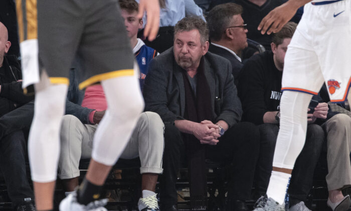 New York Knicks owner James Dolan (C) watches the game action in the first half of an NBA basketball game against the Oklahoma City Thunder at Madison Square Garden in New York City, on March 6, 2020. (Mary Altaffer/AP Photo)