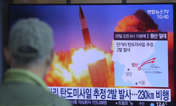 A man watches a TV screen showing a file image of North Korea's missile launch during a news program at the Seoul Railway Station in Seoul, South Korea on March 29, 2020. (Ahn Young-joon/AP Photo)
