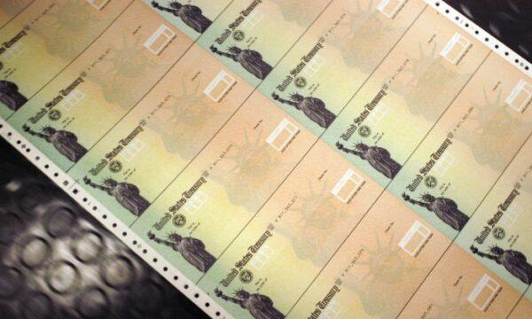 Blank Social Security checks are run through a printer