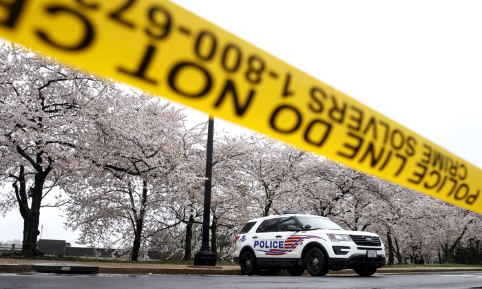 A Washington, D.C. Metropolitan Police vehicle is parked on the other side of a tape police line along the Tidal Basin, in Washington on March 23, 2020. (Carolyn Kaster/AP Photo)