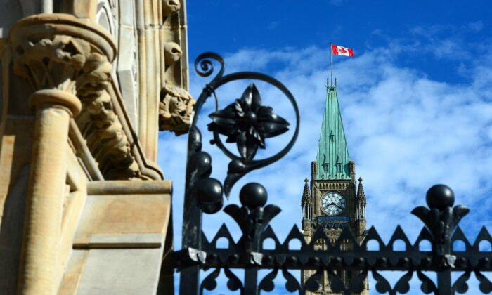 The Parliament Hill Peace Tower is seen from the front gates of Parliament Hill in Ottawa on June 19, 2017. (The Canadian Press/Sean Kilpatrick)