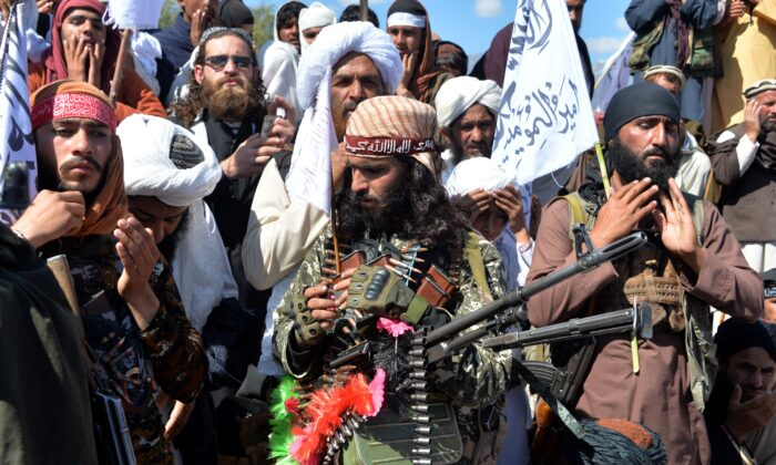 Afghan Taliban fighters and villagers attend a gathering as they celebrate the peace deal and their victory in the Afghan conflict on US in Afghanistan, in Alingar district of Laghman Province on March 2, 2020. (Noorullah Shirzada /AFP via Getty Images)