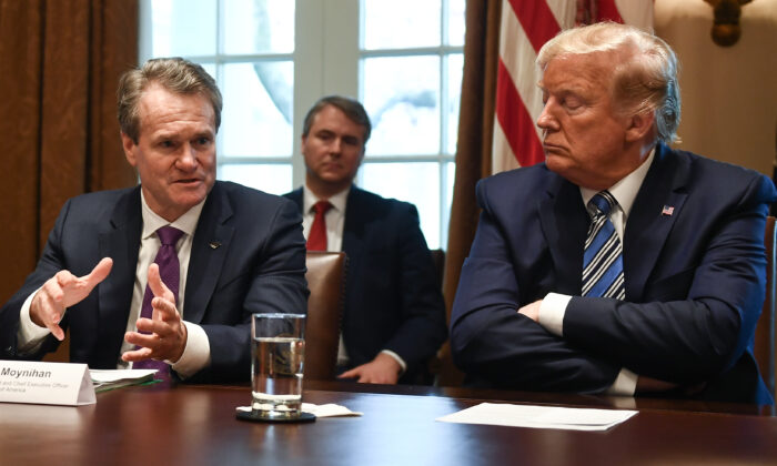 U.S. President Donald Trump gestures as CEO of Bank of America Brian Moynihan (L) speaks during a meeting with banking leaders to discuss how the financial services industry can meet the needs of customers affected by COVID-19 at the White House in Washington, DC on March 11, 2020. (Brendan Smialowski /AFP via Getty Images)