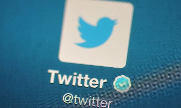 The Twitter logo is displayed on a mobile device in London on Nov. 7, 2013. (Bethany Clarke/Getty Images)