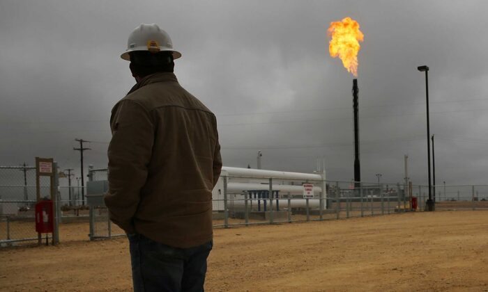Flared natural gas is burned off at Apache Corporations operations at the Deadwood natural gas plant in the Permian Basin in Garden City, Texas, on Feb. 5, 2015. (Spencer Platt/Getty Images)
