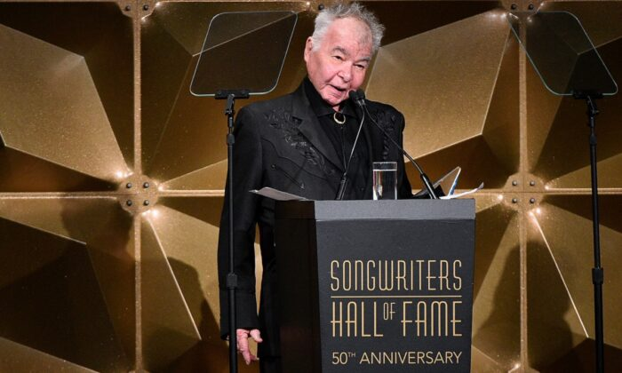 Inductee John Prine speaks onstage during the Songwriters Hall of Fame 50th Annual Induction and Awards Dinner at The New York Marriott Marquis in New York City on June 13, 2019. (Theo Wargo/Getty Images for Songwriters Hall Of Fame )
