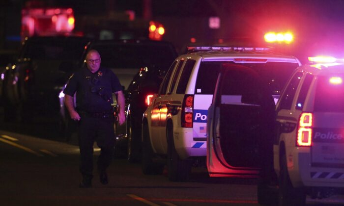 A Phoenix Police officer arrives on the scene of a shooting in Phoenix, Ariz., on March 29, 2020. At least three Phoenix police officers were shot Sunday night on the city's north side, authorities said. (Ross D. Franklin/AP Photo)