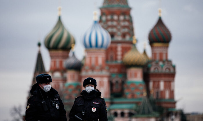 Russian police officers patrol on the deserted Red square in front of Saint Basil's Cathedral in Moscow as the city and its surrounding regions imposed lockdowns today, that were being followed by other Russian regions in a bid to slow the spread of the COVID-19 infection caused by the novel coronavirus, Moscow, Russia , on March 30, 2020. (Dimitar Dilkoff /AFP via Getty Images)