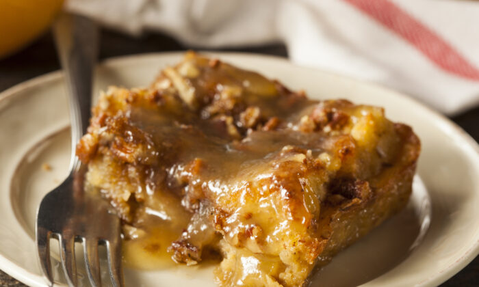 Rum sauce elevates a simple, frugal southern bread pudding. (Brent Hofacker/Shutterstock)