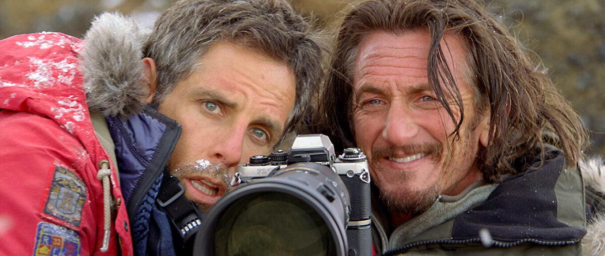 Two men behind a big camera