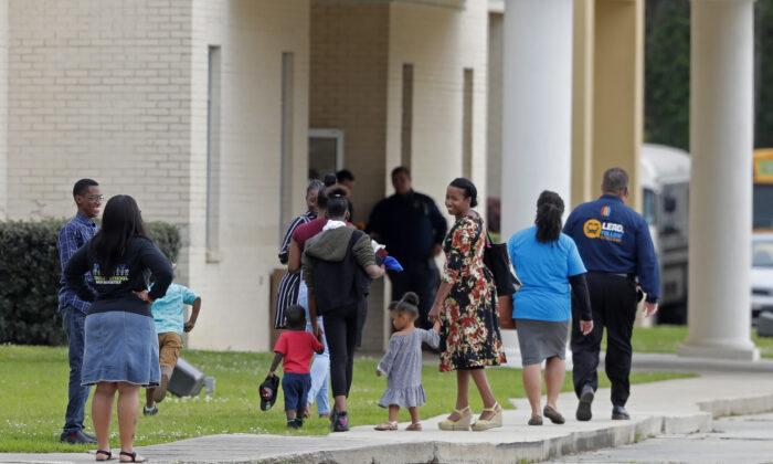 Congregants arrive at the Life Tabernacle Church in Central, Louisiana, on March 29, 2020. (Gerald Herbert/AP Photo)
