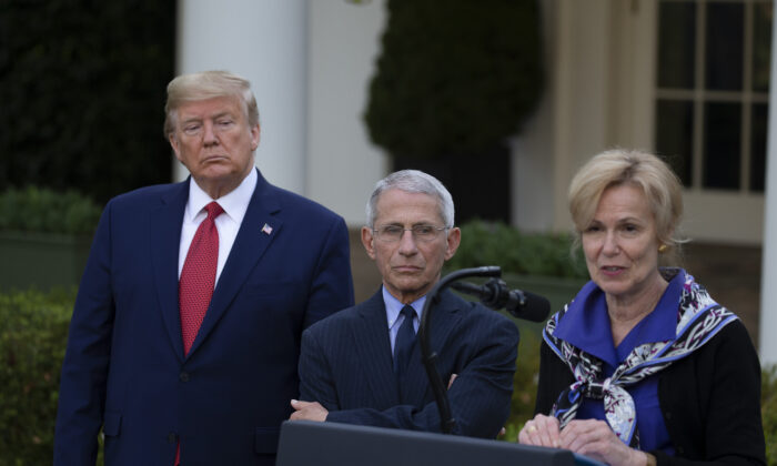 President Donald Trump and Dr. Anthony Fauci, director of the National Institute of Allergy and Infectious Diseases, listen to White House coronavirus response coordinator Dr. Deborah Birx speak in the Rose Garden at the White House in Washington on March 29, 2020. (Tasos Katopodis/Getty Images)