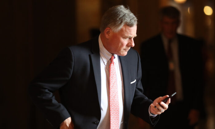 Sen Richard Burr (R-N.C.) takes a phone call during the weekly Republican policy luncheon in Washington on Sept. 25, 2018. (Win McNamee/Getty Images)