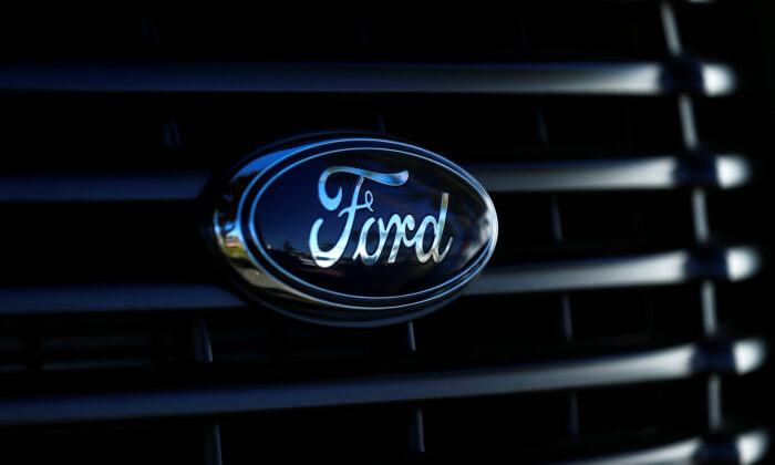 The front grill logo of a Ford pickup truck is seen in this photo taken in Carlsbad, Calif., Nov. 5, 2014. (Mike Blake/Reuters)