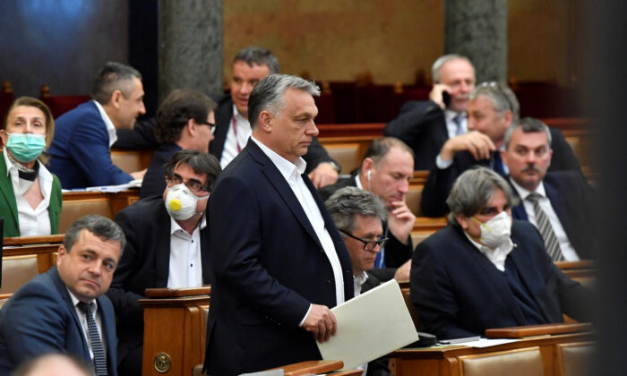 Hungarian Prime Minister Viktor Orban arrives to attend the plenary session of the Parliament ahead of a vote to grant the government special powers to combat the CCP virus disease (COVID-19) crisis in Budapest, Hungary, on March 30, 2020. (Zoltan Mathe/Pool via Reuters)
