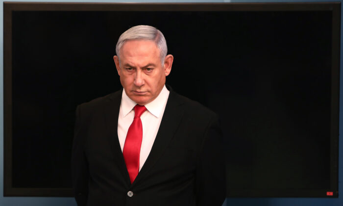 Israeli Prime Minister Benjamin Netanyahu arrives for a speech at his Jerusalem office on March 14, 2020. (Gali Tibbon/AFP via Getty Images)