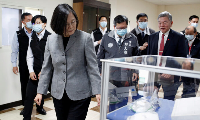 Taiwanese president Tsai Ing-Wen visits a non woven filter fabric factory, where the fabric is used to make surgical face masks, in Taoyuan, Taiwan, on March 30, 2020. (Ann Wang/Reuters)