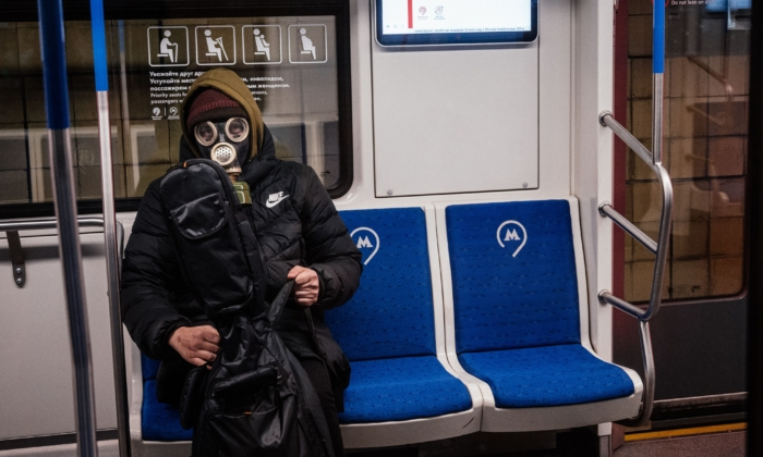 A man wearing a gas mask sits in a Moscow subway car on March 31, 2020. (Dimitar Dilkoff/AFP via Getty Images)