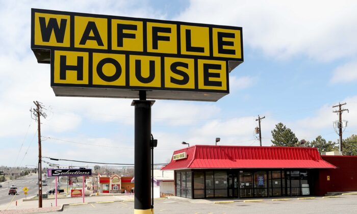 A Waffle House restaurant sits closed after the restaurant chain closed at least 420 locations due to the COVID-19 crisis in Thornton, Col., on March 26, 2020. (Matthew Stockman/Getty Images)