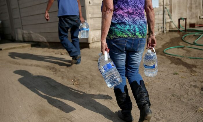 Water is delivered to residents facing severe water shortage in Porterville, California on April 23, 2015. A group of water advocates urged the state administration on March 30, 2020 for an immediate statewide moratorium on water shutoffs amid COVID-19 pandemic. (Justin Sullivan/Getty Images)