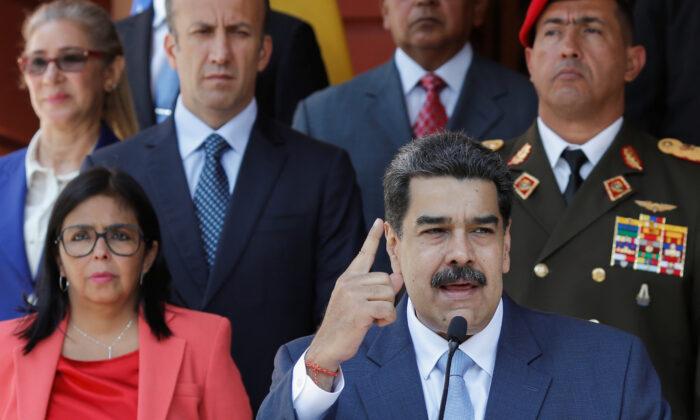 Venezuelan regime leader Nicolas Maduro speaks during a news conference at Miraflores Palace in Caracas, Venezuela, March 12, 2020. (Manaure Quintero/Reuters)