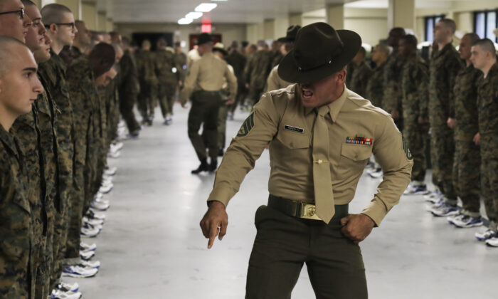 A drill instructor corrects recruits on their deficiencies on Marine Corps Recruit Depot Parris Island, S.C., on Nov. 16, 2019. (U.S. Marine Corps photo by Lance Cpl. Godfrey Ampong)