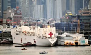 USNS Comfort Crew Member Tests Positive As Ship Begins Taking in Virus Patients