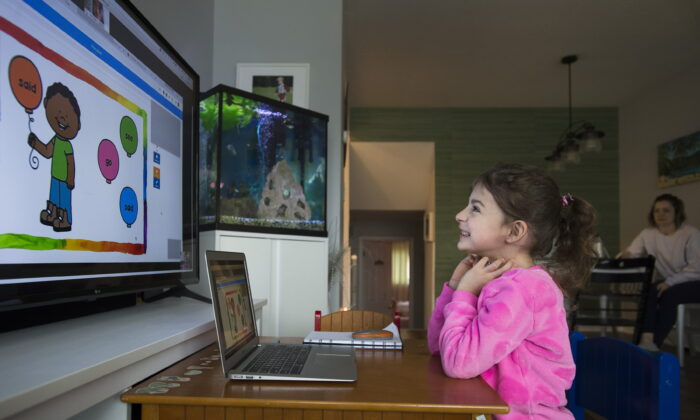 Six-year-old Peyton Denette works on her speech and language skills with speech-language pathologist Olivia Chiu of Two Can Talk remotely from her home in Mississauga, Ont., on March 30, 2020. (Nathan Denette/The Canadian Press)