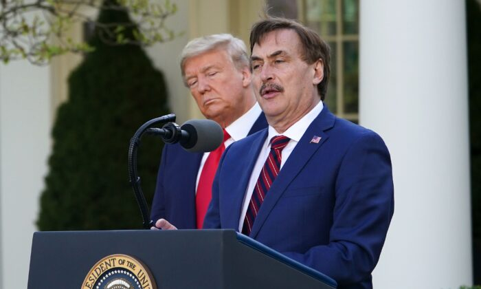President Donald Trump listens as Michael J. Lindell, CEO of MyPillow Inc., speaks during the daily briefing on the CCP virus, in the Rose Garden of the White House in Washington, on March 30, 2020. (Mandel Ngan/AFP via Getty Images)
