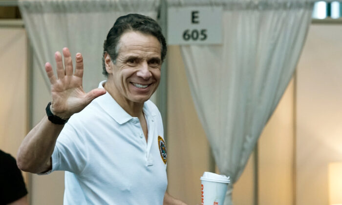New York Gov Andrew Cuomo waves after giving a daily coronavirus press conference at the Jacob K. Javits Convention Center, which is being turned into a hospital to help fight CCP virus cases in New York City on March 27, 2020. (Eduardo Munoz Alvarez/Getty Images)