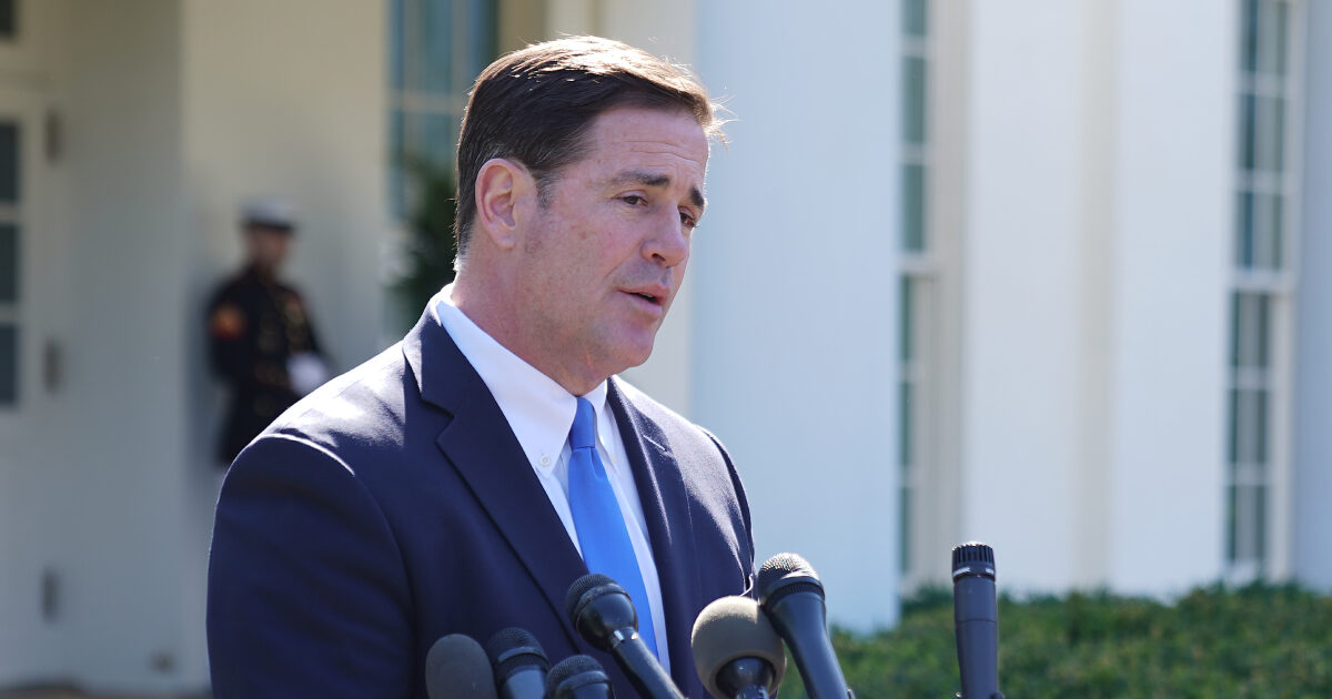 Doug Ducey talks to reporters after meeting