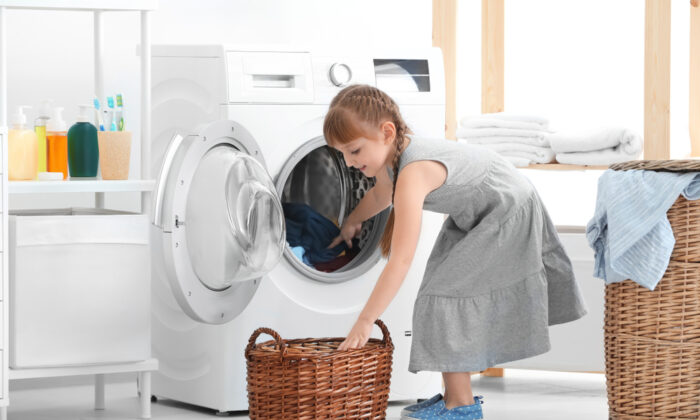 Kids don't learn how to do laundry in school but they sure do in homeschool. (Africa Studio/Shutterstock)