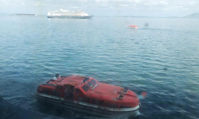 A tender approaches the Zaandam, a Holland America cruise ship off Panama, on March 28,2020. (Juan Huergo via AP)