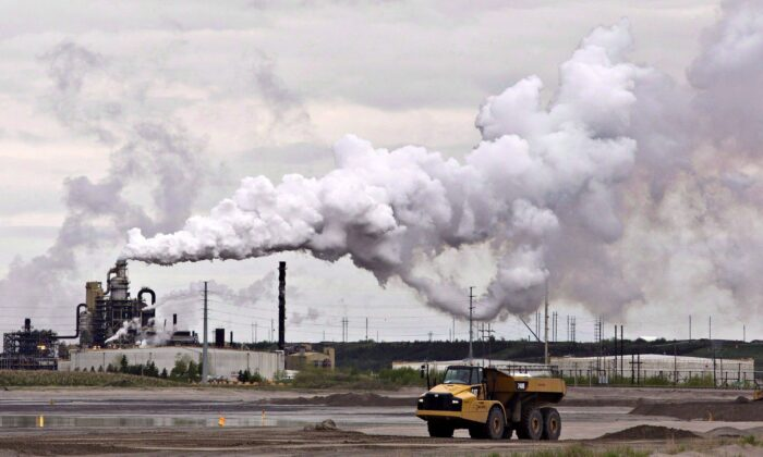A dump truck works near the Syncrude oilsands extraction facility near the city of Fort McMurray, Alberta, in a file photo. (The Canadian Press/Jason Franson)