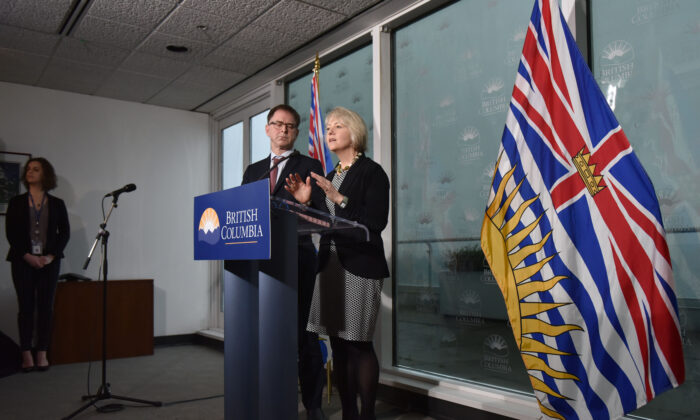 British Columbia Minister of Health Adrian Dix and Dr. Bonnie Henry, provincial health officer, speak to the media on the novel coronavirus in Vancouver, British Columbia, on Jan. 31, 2020. (Don Mackinon/AFP via Getty Images)
